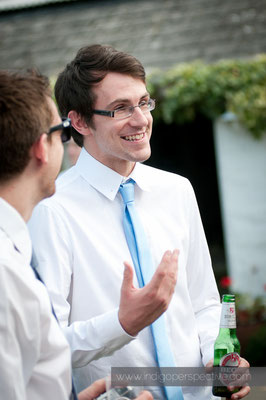 38-weirmarsh-farm-wedding-north-devon-male-guest-smile-chat