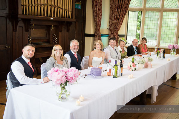 37-woolhanger-manor-wedding-photography-north-devon-top-table-smiles