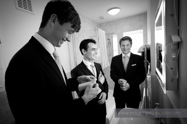 6-woolacombe-barricane-beach-wedding-north-devon-groom-prep-mirror-ties