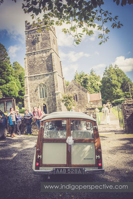 21-tipi-wedding-photography-north-devon-church-arrival-car