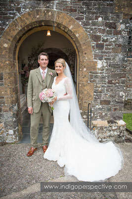 25-tipi-wedding-photography-north-devon-bride-groom-outside-church