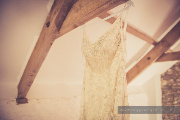 4-westcott-barton-wedding-photography-north-devon-dress-hanging-beams