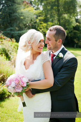 30-weirmarsh-farm-wedding-north-devon-bride-groom-look-smile