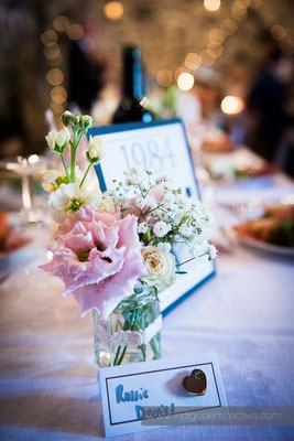 39-westcott-barton-wedding-photography-north-devon-table-flowers