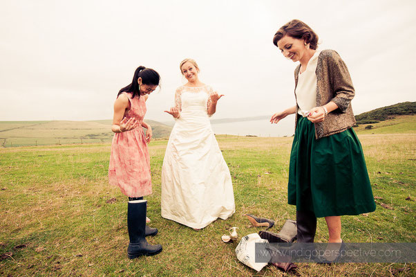 40-woolacombe-barricane-beach-wedding-north-devon-guests-wellies-bride-smiles