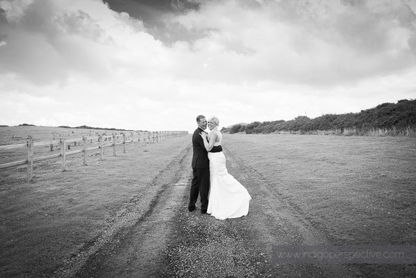 65-ocean-kave-wedding-photography-north-devon-bride-groom-looking-back