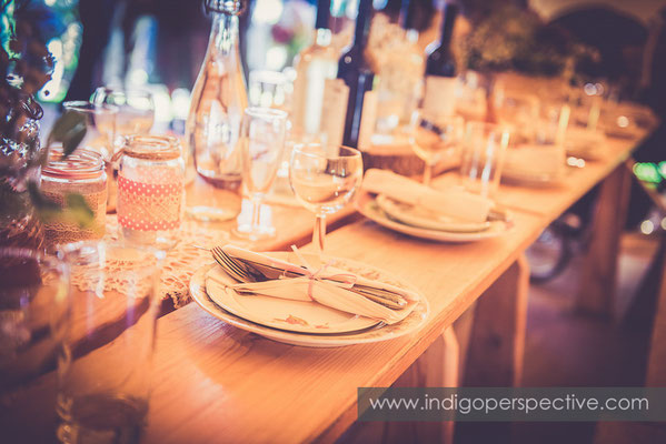 44-tipi-wedding-photography-north-devon-tables-glasses-plates-rustic