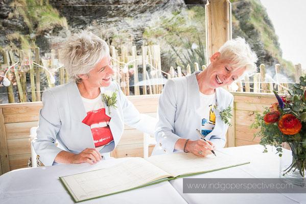 23-tunnels-beaches-same-sex-wedding-photography-north-devon-signing-register