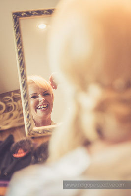 11-ocean-kave-wedding-photography-north-devon-bride-hair-mirror-smiles
