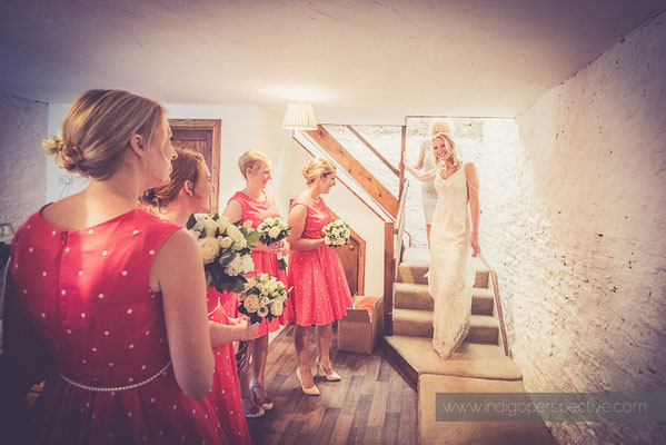 10-westcott-barton-wedding-photography-north-devon-bride-stairs-bridesmaids