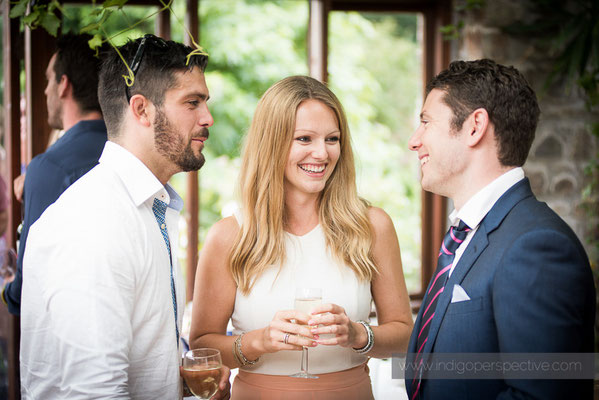 64-westcott-barton-wedding-photography-north-devon-guests-chat-smile