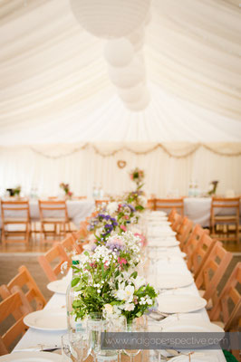 30-woolacombe-barricane-beach-wedding-north-devon-marquee-interior-dressing-table-flowers