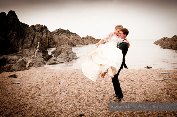 22-woolacombe-barricane-beach-wedding-north-devon-bride-groom-dance-beach-lift