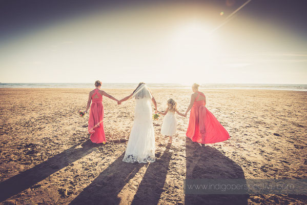 73-woolacombe-bay-hotel-wedding-photography-north-devon-bridesmaids-beach-holding-hands