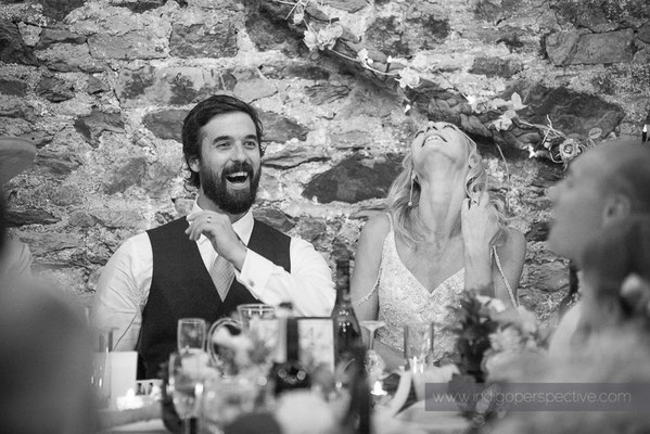 47-westcott-barton-wedding-photography-north-devon-bestman-speech-bride-groom-laughter