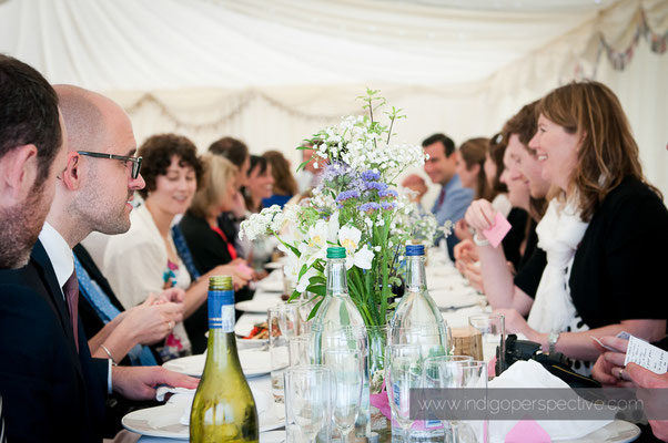 51-woolacombe-barricane-beach-wedding-north-devon-table-guests-chat-informal