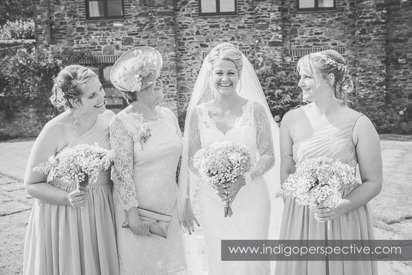 12-tipi-wedding-photography-north-devon-bride-mum-bridesmiads-sunshine-flowers-laughing