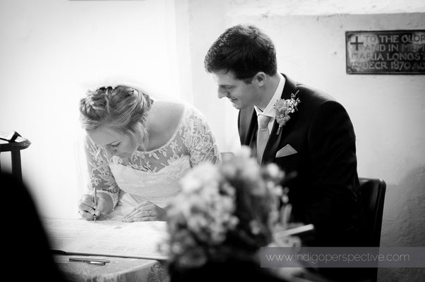 13-woolacombe-barricane-beach-wedding-north-devon-mortehoe-church-bride-groom-signing-register