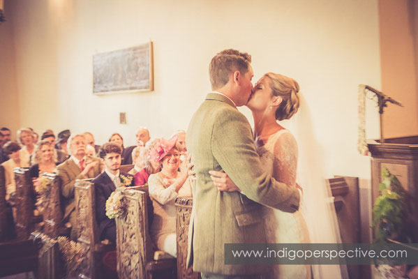 24-tipi-wedding-photography-north-devon-bride-groom-kiss