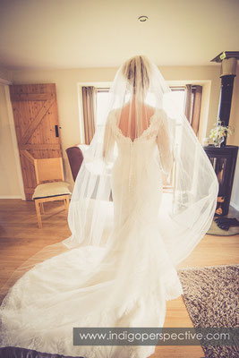 14-tipi-wedding-photography-north-devon-bride-dress-behind-veil