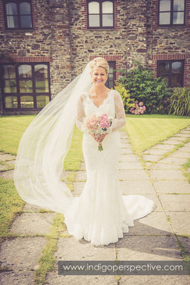 16-tipi-wedding-photography-north-devon-bride-flowers-veil-blowing-wind