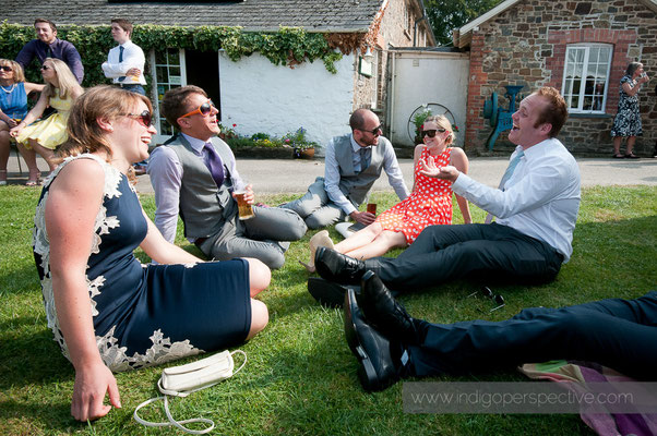 36-weirmarsh-farm-wedding-north-devon-guests-informal-smile-chat