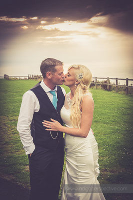 118-ocean-kave-wedding-photography-north-devon-evening-kiss-bride-groom
