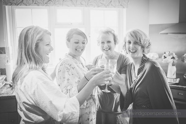 5-woolhanger-manor-wedding-photography-north-devon-bride-bridesmaid-champagne-toast