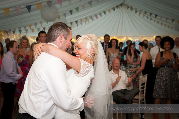 49-weirmarsh-farm-wedding-north-devon-bride-groom-first-dance-smile