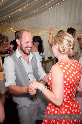 55-weirmarsh-farm-wedding-north-devon-guest-evening-party-smile