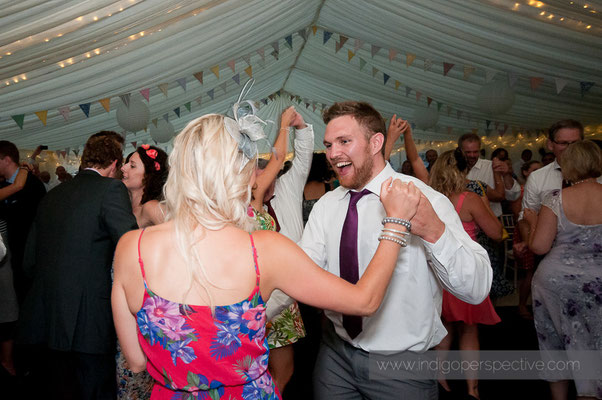 54-weirmarsh-farm-wedding-north-devon-guest-dance-smile