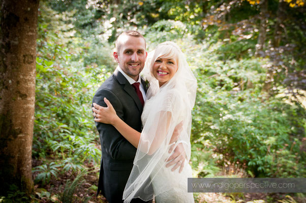 28-weirmarsh-farm-wedding-north-devon-bride-groom-smile-hug
