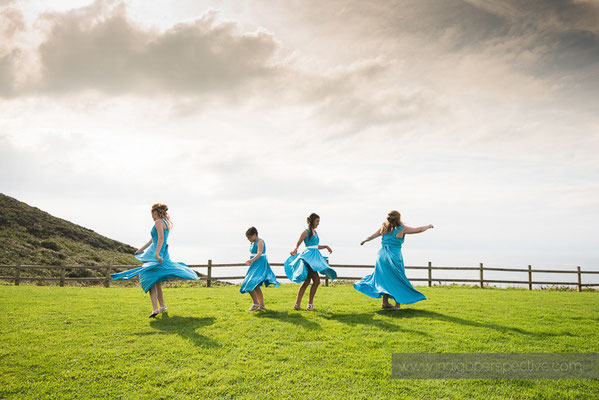 98-ocean-kave-wedding-photography-north-devon-bridesmaids-dresses-twirl-spin