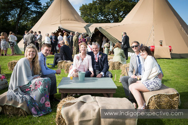 50-tipi-wedding-photography-north-devon-guests-haybales