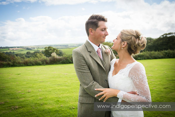 36-tipi-wedding-photography-north-devon-bride-groom-countryside-field