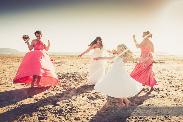 68-woolacombe-bay-hotel-wedding-photography-north-devon-bridesmaids-spin-twirl-beach
