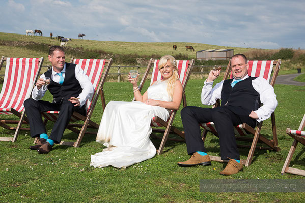 99-ocean-kave-wedding-photography-north-devon-bride-groom-cigars-deckchairs