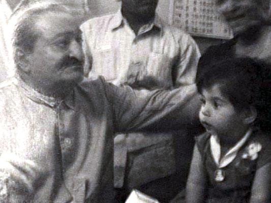 Meher Baba with baby Mehera