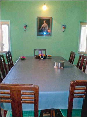The dining room table with Baba's chair at the far end