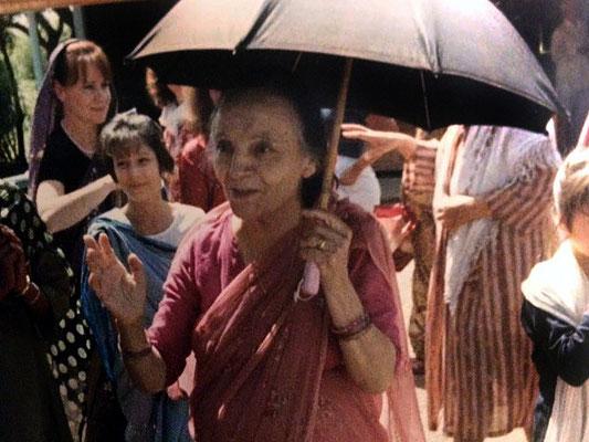 Rainy with Mehera holding umbrella
