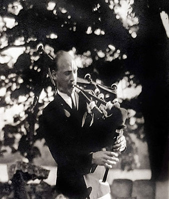 1933 - Kenneth playing the bagpipes in Connecticut ( cropped image ). Photo Courtesy of Anne Ross. Image edited by Anthony Zois