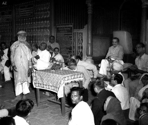 6th Nov.  Meher Baba listening to Saint Gadge Maharaj at his  Dharamshala, Pandharpur