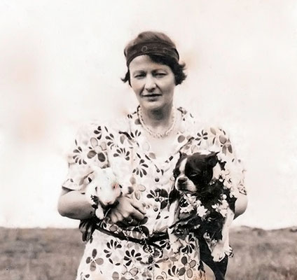Elizabeth Patterson holding Kippr the Boston Terrier & a rabbit