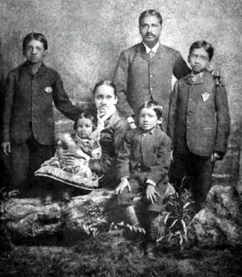 Aurobindo seated in the centre along with his parents and siblings.