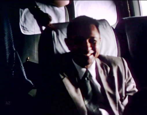 Meherjee Karkaria sitting opposite Meher Baba flying from Newark, NY to Wilmington NC., on this plane. flying from Newark, NY to Wilmington NC., on this plane. Image captured from a film by Anthony Zois