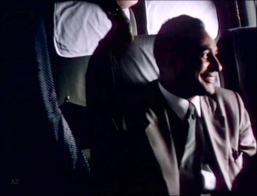 Meherjee Karkaria sitting opposite Meher Baba flying from Newark, NY to Wilmington NC., on this plane. Image captured from a film by Anthony Zois