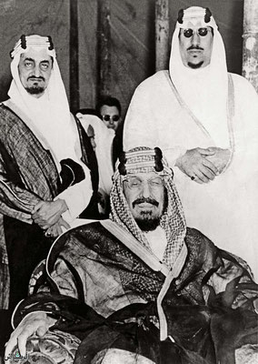 Crown Prince Saud ( right ) with his father King Abdulaziz -seated and brother Prince Faisal -later king, left, early 1950s