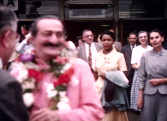 Idlewild Airport : Meher Baba greeted by his entourage outside the airport. Beryl Williams ( L ) & Ella Winterfeldt ( R ) look on. Image captured from a film by Anthony Zois