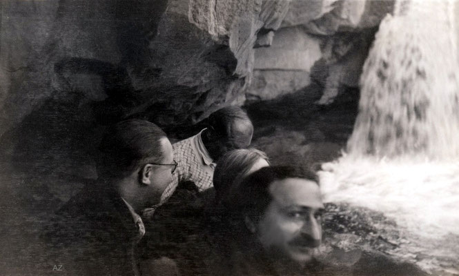 Meher Baba at a waterfall & caves with Garrett Fort ( right ).