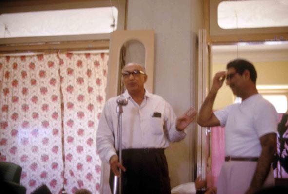 Sarosh Irani speaking with Eruch next to him. Courtesy of Larry & Rita Karrasch